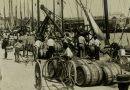 Loading vessels with barrels of sugar cane syrup at the docks of Bridgetown